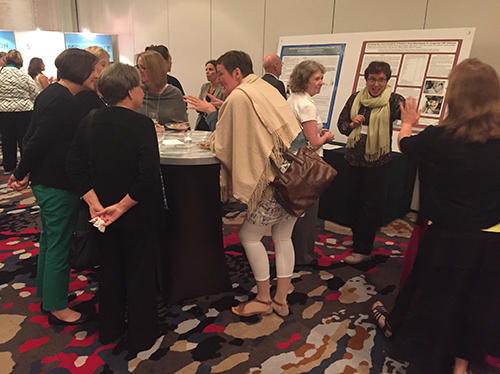 2016 CMV Conference Reception, attendees networking and discussing posters
